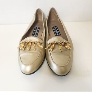 Stuart Weitzman gold leather loafers with charms